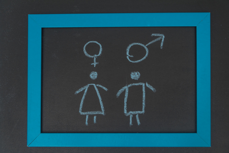 on the chalkboard sign woman, man graphic, sexually active, frigid