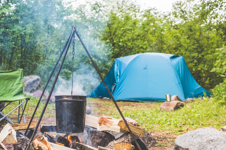 camping, tent and fire in the forest