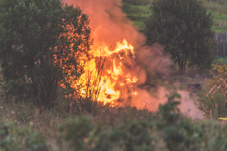 wooden private house in gardening on fire