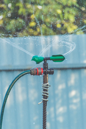 a automatic watering system with water drops in the garden