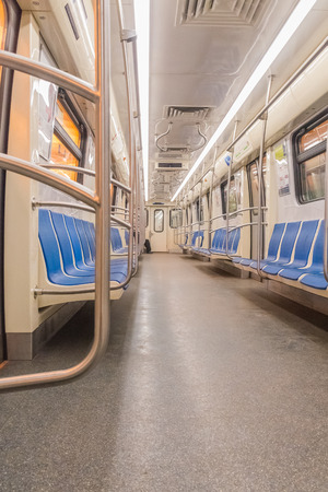 the subway car without people, empty passengers, seats