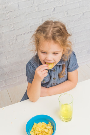 girl, baby eating potato chips and drinking soda, not healthy food