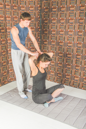 the man and woman on the floor Thai yoga massage, stretching and gymnastics, sports and health Banco de Imagens