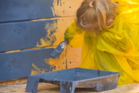 the child paints a house brush out