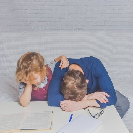 the dad and daughter do homework after primary school Stock fotó - 132395404