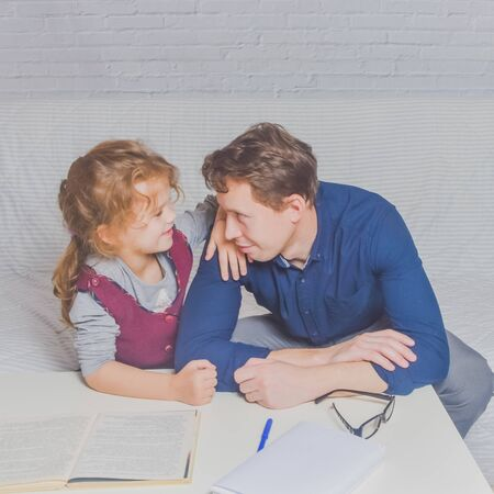 the dad and daughter do homework after primary school
