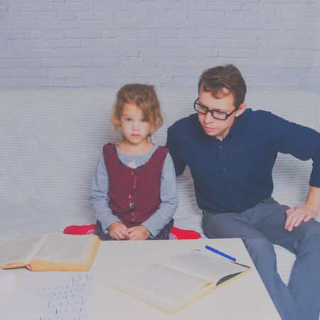 the dad and daughter do homework after primary school Stock fotó - 132395421