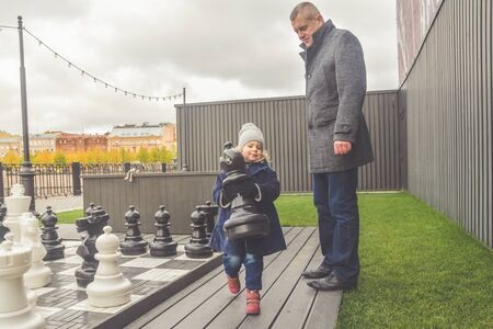 the family baby dad mom Playground play autumn outside chess
