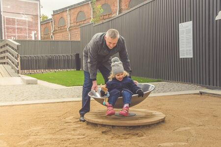 the family baby dad mom Playground play autumn Stock fotó - 132395599