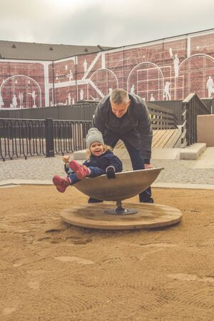 the family baby dad mom Playground play autumn