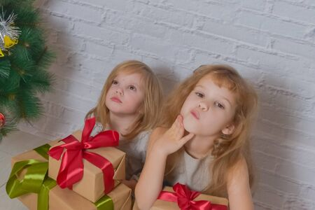 the day with gifts and Christmas tree two girls sisters Stock fotó - 133329689