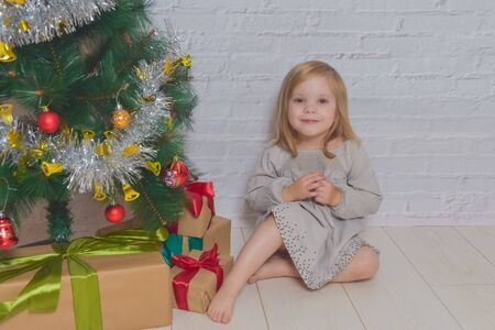 the day with gifts and Christmas tree two girls sisters Stock fotó - 133329700