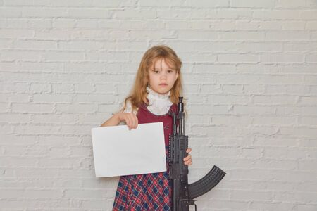 the child in a school uniform with a weapon