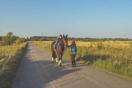 Russia Nikolskoye September 23, 2020 - boy rides a horse hippotherapy class 에디토리얼