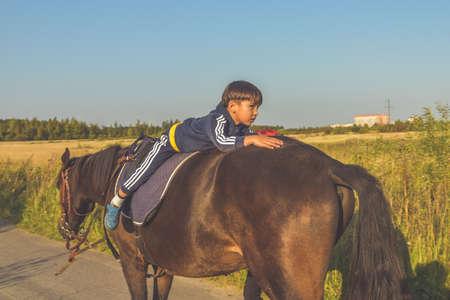 Russia Nikolskoye September 23, 2020 - boy rides a horse hippotherapy class