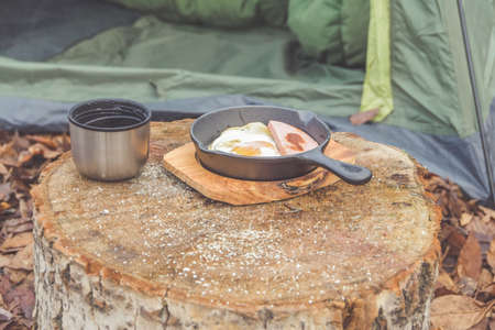 the hot tea and scrambled eggs are served for Breakfast at the campsite