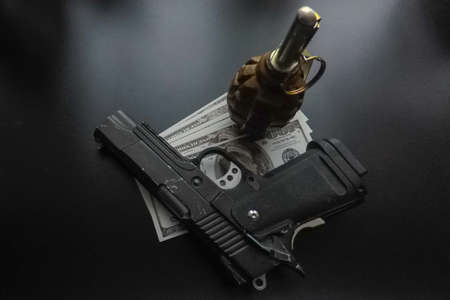 the black background a pistol and a hand grenade 版權商用圖片
