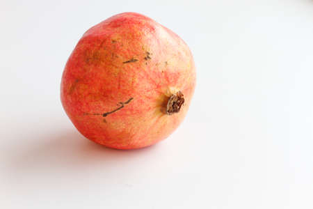 Red pomegranate isolated on white background