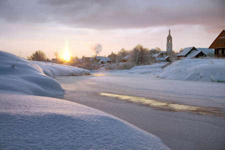 frozen river: The morning sun illuminates the frozen river in winter