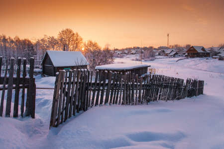 fense: Village under snow at dawn