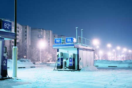 Gas station at night city lights of winter
