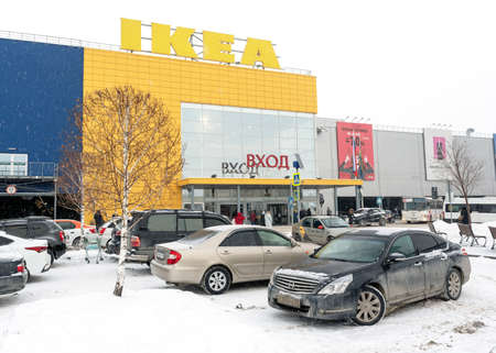 Novosibirsk, Russia-December 30, 2018 Nissan car Teanaand others are in the Parking lot of the shopping center IKEA  in the winter of Christmas in Novosibirsk December 30, 2018.
