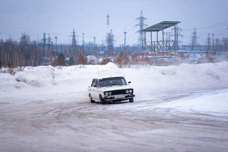 Russia, Novosibirsk - November 30, 2019. Russian modified white car