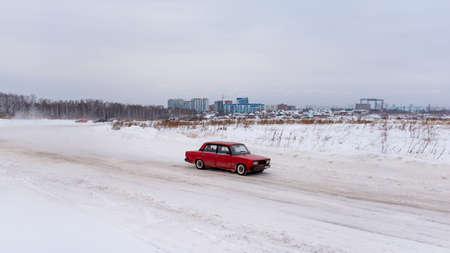 Russia, Novosibirsk - November 30, 2019. Russian low red car