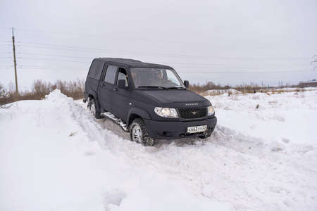 Russia, Novosibirsk-March 5, 2020. Russian black 4x4 SUV in protective paint Raptor