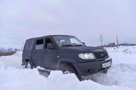 Russia, Novosibirsk-March 5, 2020. Russian black 4x4 SUV in protective paint