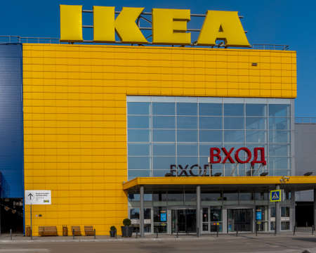 Novosibirsk, Russia-April 12, 2020. Sign online product fence on the wall in the IKEA hypermarket due to the quarantine of the covid 19 virus epidemic without cars and people at the closed entrance.