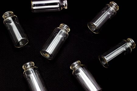 glass test tubes on a dark background