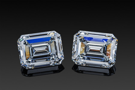 colorless transparent sparkling set of two luxury gemstones square shape emerald cut diamonds  isolated on black background.