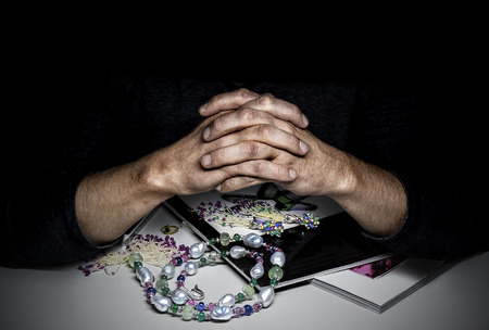 The Jewelry expert appraiser with his fingers crossed. Stock Photo
