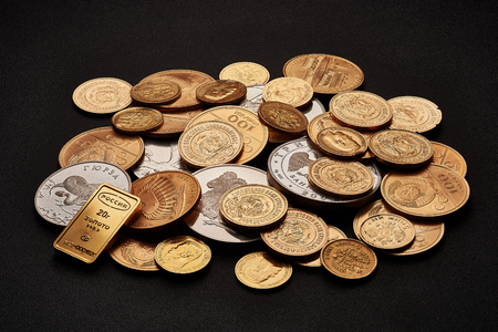 White and yellow gold bars and coins isolated on black background.