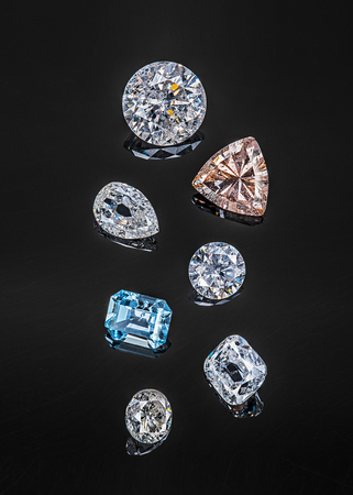 Colorful precious stones isolated on black background.