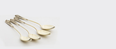 Vintage Tea Spoons isolated on white background.