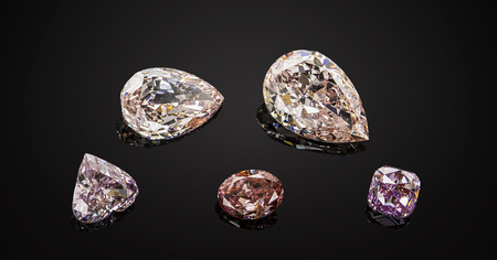 Set of luxury pink and purple transparent sparkling gemstones of various cut shape diamonds collage on black background. Stock Photo