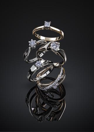 engagement diamond wedding ring group isolated on black background. Imagens