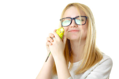 perplexing: A girl with glasses and a parrot Stock Photo