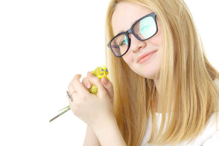 visually: A girl with glasses and a parrot Stock Photo