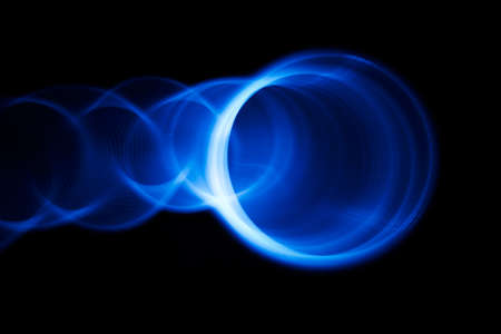 hypnosis: Sound waves in the visible blue color in the dark Stock Photo