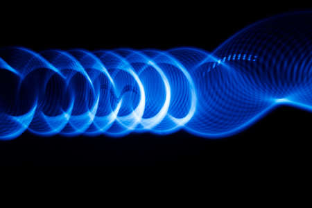 color in: Sound waves in the visible blue color in the dark Foto de archivo