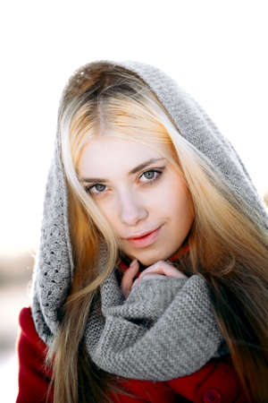 warms: A young woman warms frozen hands down shawls Stock Photo