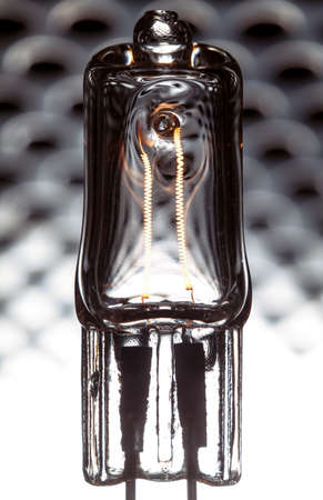 ampere: Halogen lamp powered with visible incandescent filaments inside