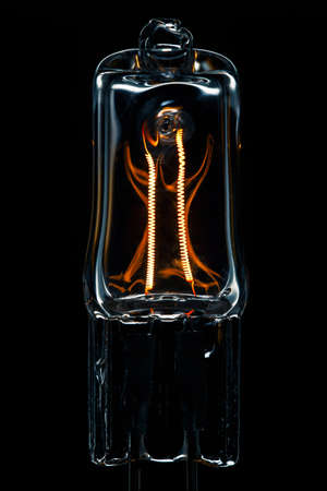 lumen: Halogen lamp powered with visible incandescent filaments inside