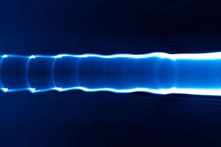 color in: Sound waves in the visible blue color in the dark Foto de archivo