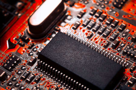 basic scheme: Bokeh electronic circuit close up computer in red colors Stock Photo