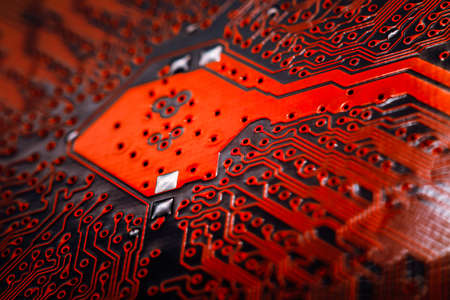 basic scheme: Bokeh electronic circuit close up computer in red colors. Selective focus Stock Photo