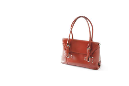 Red glossy female leather bag isolated on white background